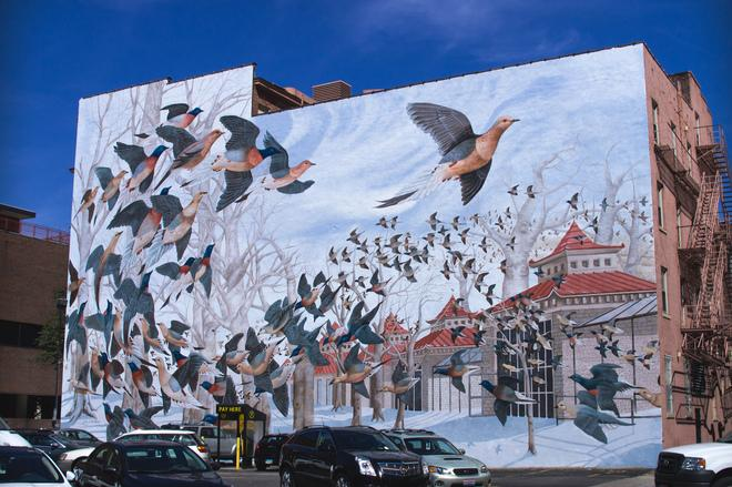 "ArtWorks mural at Eighth and Vine streets reproduces an original masterpiece by John Ruthven, ""Martha, the Last Passenger Pigeon."""