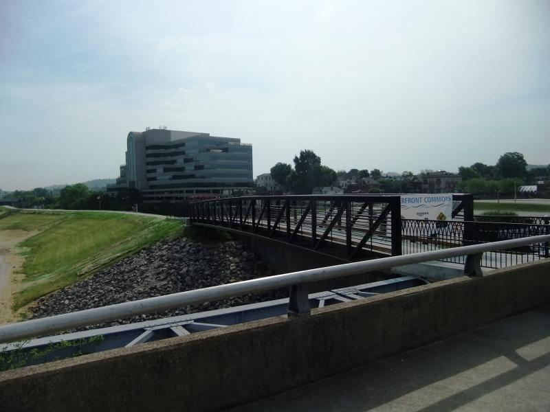 A new pedestrian bridge connects the flood wall with the Purple People Bridge.