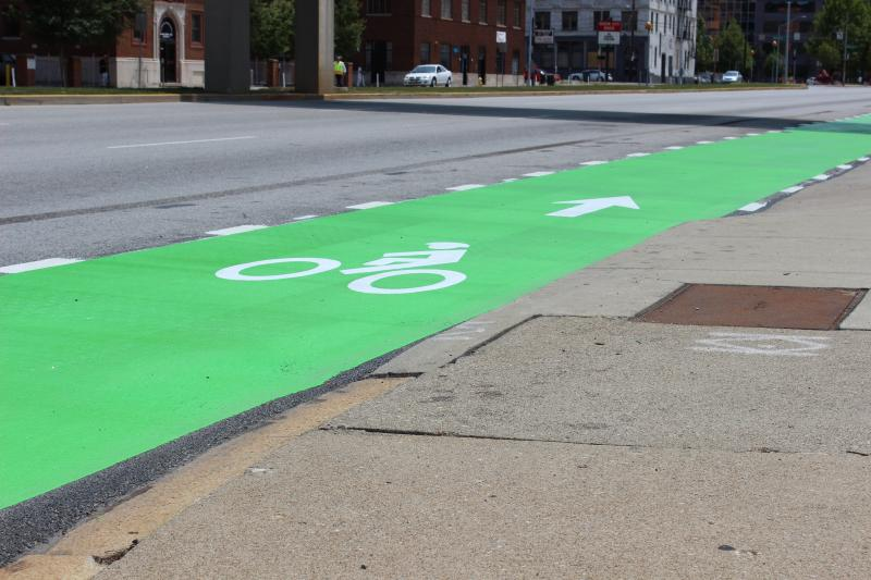 Bright green paint on Central Parkway which is part of the project to install bike lanes on the route.