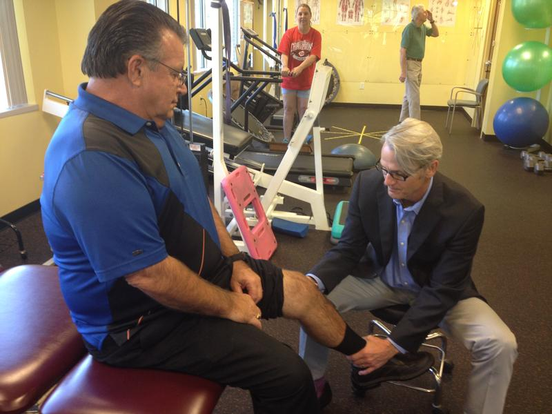 Gary Marcum, who had knee replacement surgery in November 2013, is examined by surgeon Dr. Michael Swank.