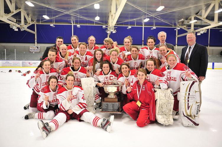The 2013-2014 Miami Redhawks club ice hockey team celebrates winning the ACHA championship.