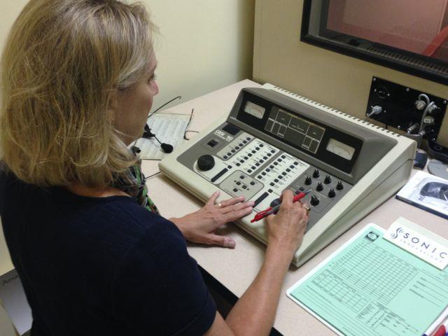 Audiologist Cindy Whitehurst, of the Mariemont Hearing Center, uses an audiometer to measure patients' hearing