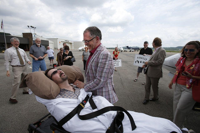 John Arthur, dying of ALS, married his long time partner Jim Obergefell on a Maryland tarmac. Obergefell won the right to be listed on Arthur's death certificate.