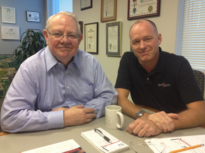 (from left) Cincinnati's TechSolve President Gary Conley and Manager Ron Pieper don't look to replace people when they advise companies on how to get more for their money. They see robots as yet another tool.