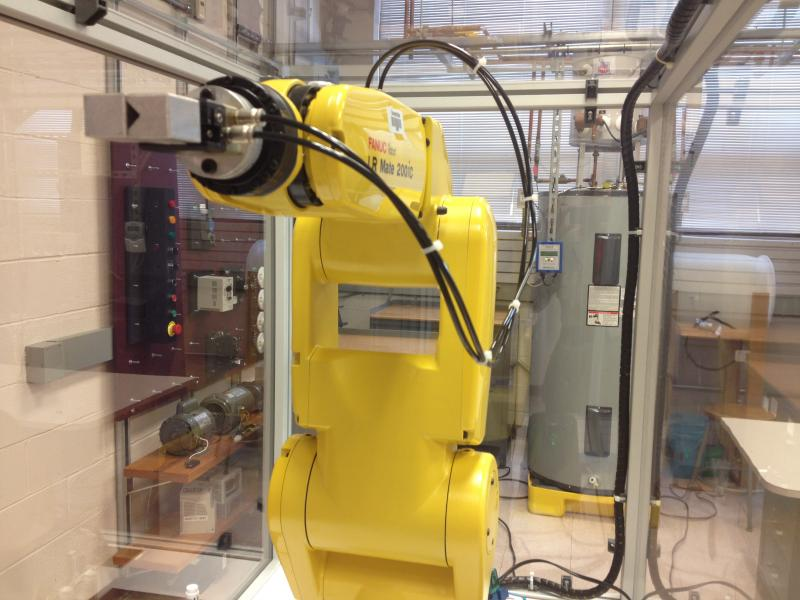 "Cincinnati State is planning to provide a ""certified robotic training"" certificate next fall. This Fanuc robot is used in class now."