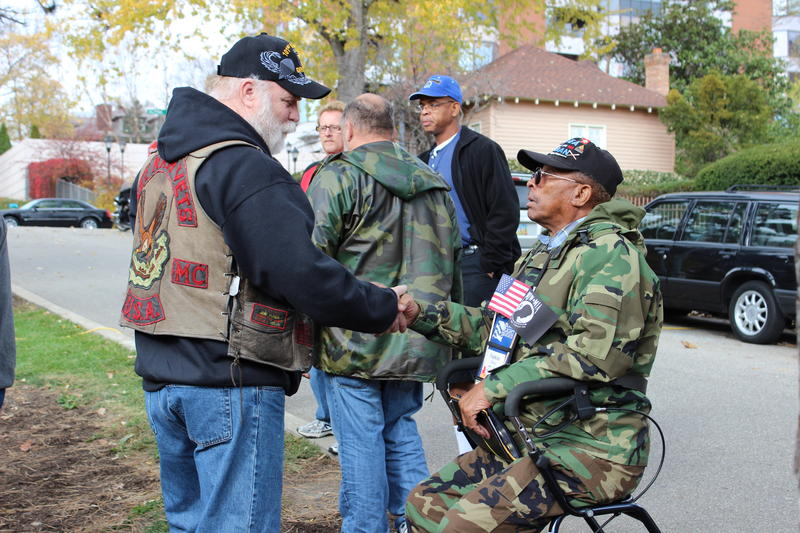 Two veterans great each other before the annual Veterans Day service in Eden Park.