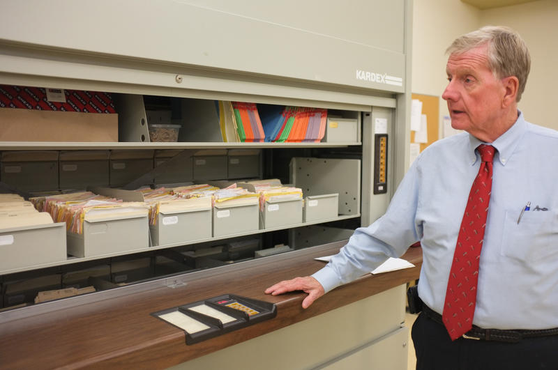 Jack Snodgrass with the files of land records in the clerk's office