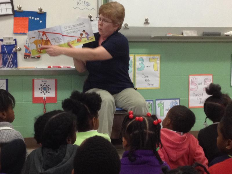 iSpace educator Sharon Young reads a book, demonstrating how a lever can lift a lion.