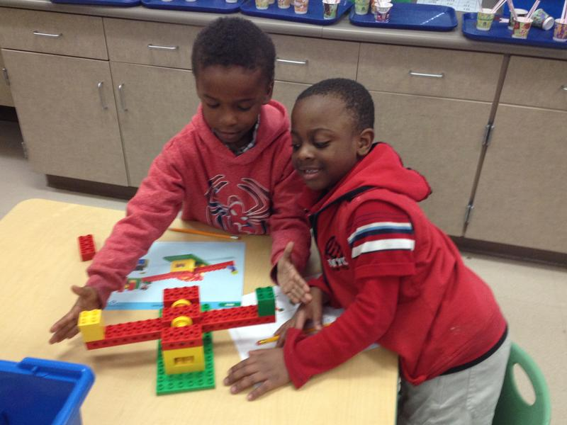 Kindergartners at Roselawn Condon School build a see-saw through a schematic.