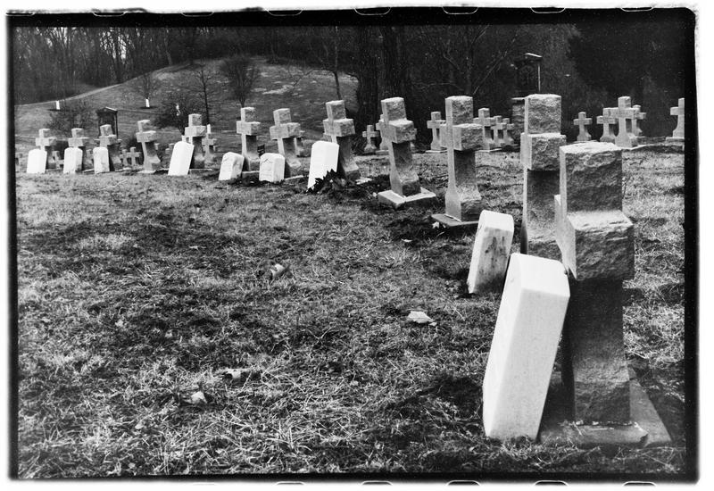 "At the Sisters of Charity cemetery, the graves of the nuns who served are marked with white ""U.S. Army Nurse"" markers."