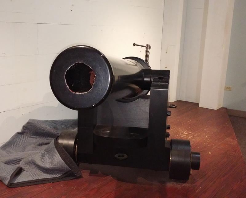 The naval cannon fired shells that weighed 30 pounds.