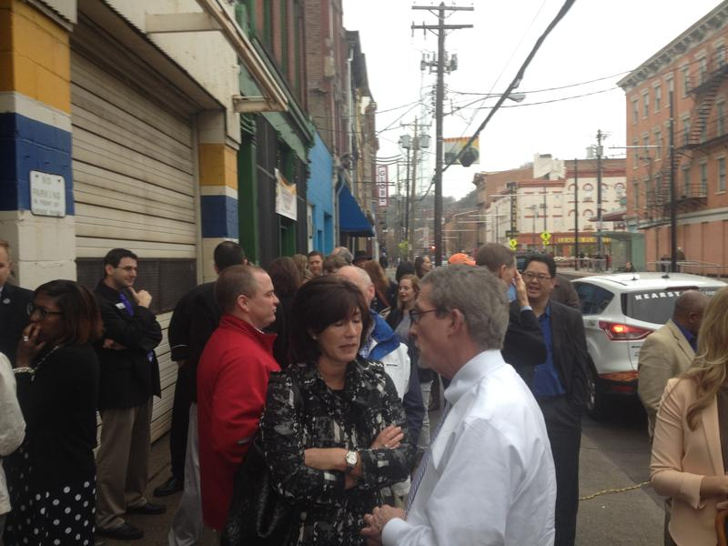Supporters of The Kitchen @ Findlay Market wait outside before Wednesday's news conference.