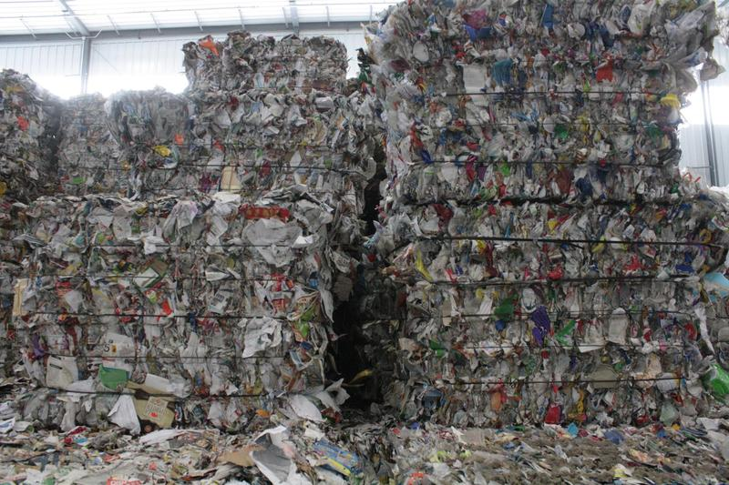 Large stacks of sorted plastics ready to be sold and recycled into new products.