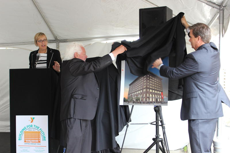 Vice Mayor David Mann (c) helps unveil renovation design plans.