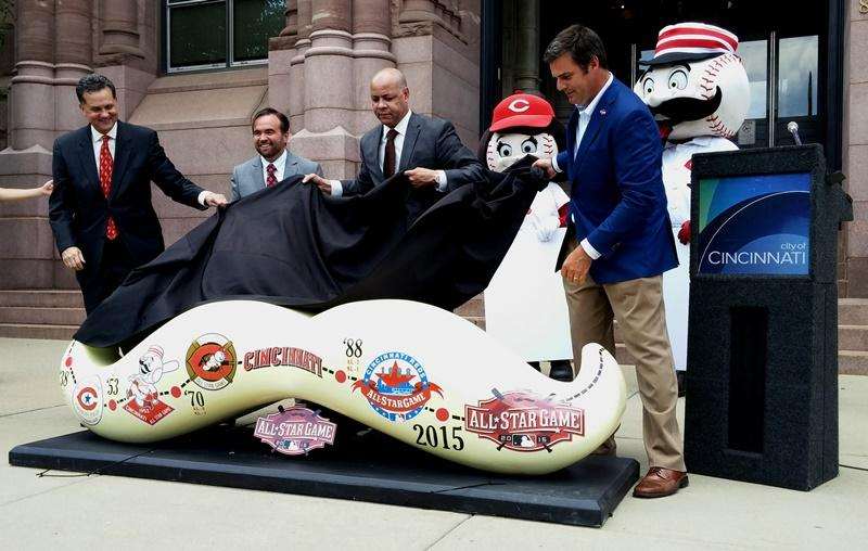 (From left) Asst. city manager Scott Stiles, Mayor John Cranley, city manager Harry Black, Rosie Red, Reds COO Phil Castellini and Mr. Redlegs unveil the first bench.