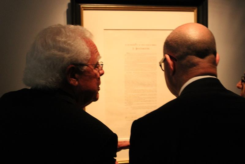 Vice mayor David Mann and City manager Harry Black examine the Emancipation Proclamation copy.