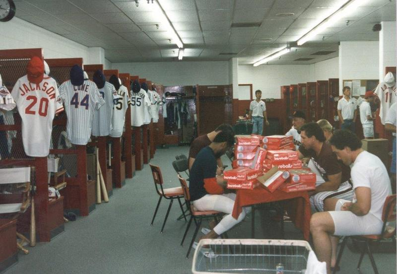National League players autographing balls in the Riverfront clubhouse before the 1988 game