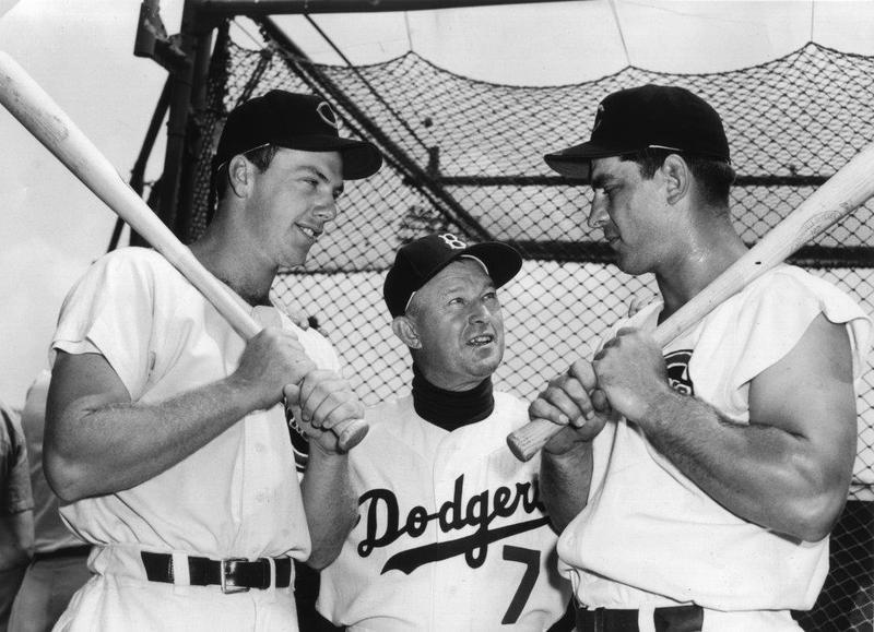 Reds All-Stars Gus Bell (l.) and Ted Kluszewski (r.) talk with National League manager Chuck Dressen before 1953 All-Star game