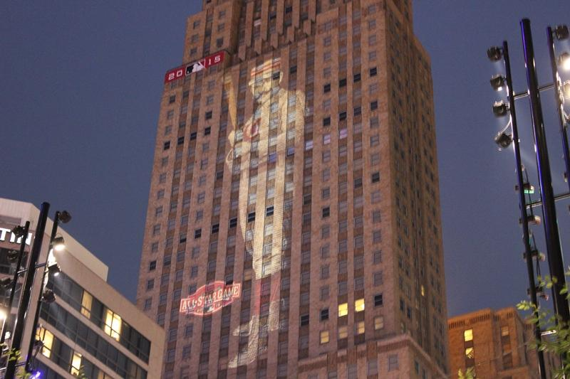 The image of a Cincinnati Red Stockings player will projected nightly on the east side of Carew Tower until July 15.