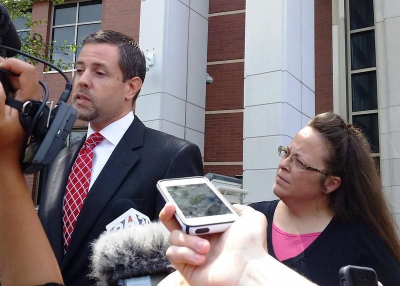 After a July District Court hearing in Covington Rowan County Clerk Kim Davis listened as her attorney spoke to reporters.