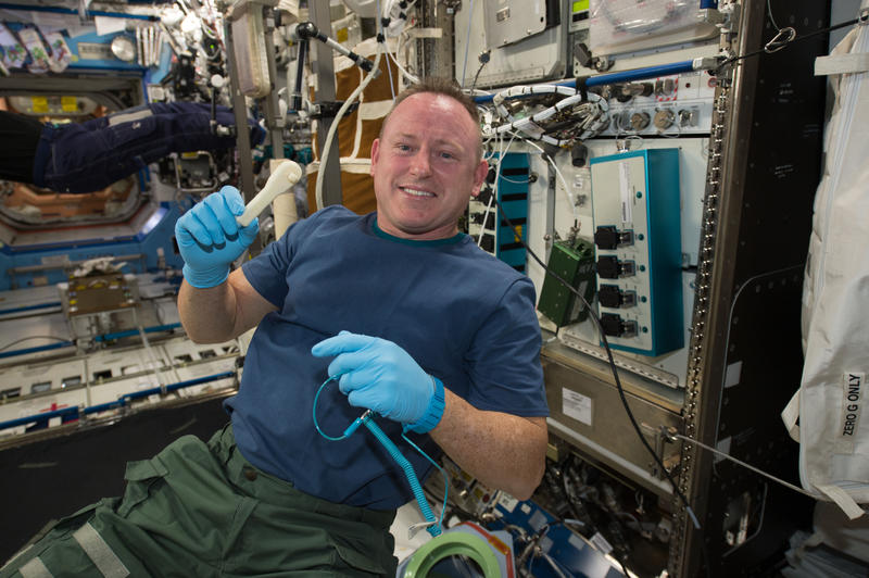 "nternational Space Station Expedition 42 Commander Barry ""Butch"" Wilmore shows off a ratchet wrench made with a 3-D printer on the station. The wrench and other parts will return to Earth for testing at NASA's Marshall Space Flight Center in Huntsville."