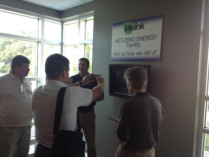 The visitors look at a dashboard, showing how much energy Melink is using.