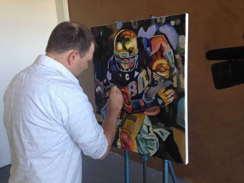 Deputy Tony Lipps uses art as a de-stresser. He puts the finishing touches on a painting of Tyler Eifert, Bengals tight end.