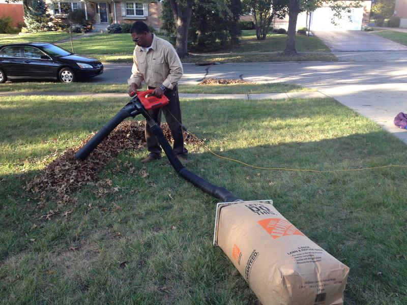 Joe Glisson tries out his invention, where leaves go directly in the yard waste bag.