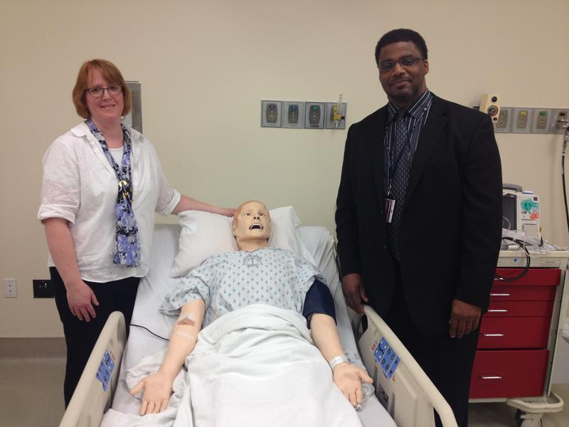 (from left) Kateri Gabriele, Dayton VA Simulation Operations Manager, Rufus, and Robert Sellers, administration officer for workforce development and medical simulation at the Dayton VA.