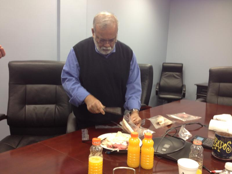 Dr. Errol Raghubeer conducts a taste test after orange juice and lunch meat is run through the HPP machine.