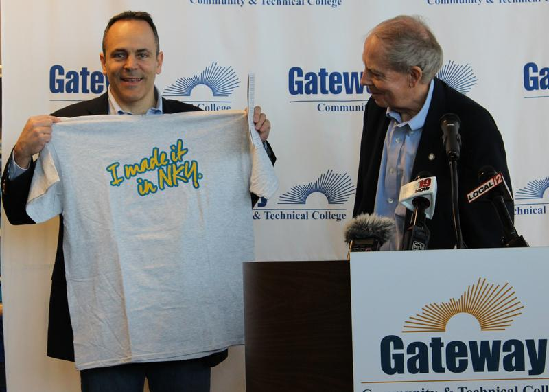 Ky. Gov. Matt Bevin holds up a t-shirt celebrating Northern Kentucky's manufacturing sector during a stop at Gateway Community College in Florence.