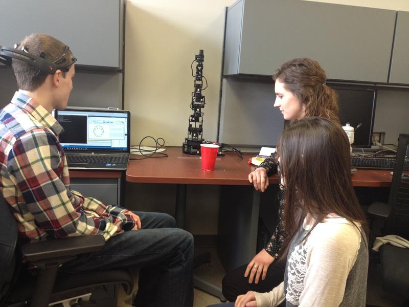 UD students Garrett Sargent, Emma Ronstadt and Victoria Dicillo expand tasks for the brain headset.