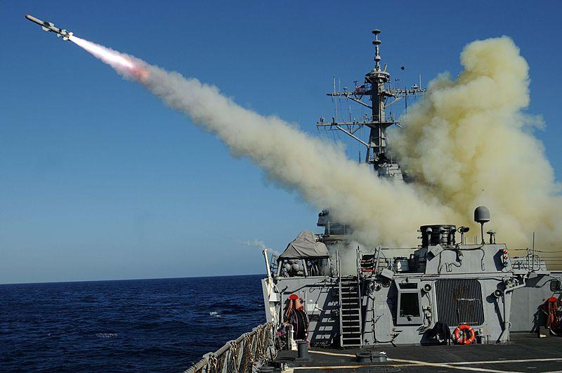 The guided-missile destroyer USS Mitscher (DDG 57) launches a Harpoon anti-ship missile at the ex-USNS Saturn during a sinking exercise.