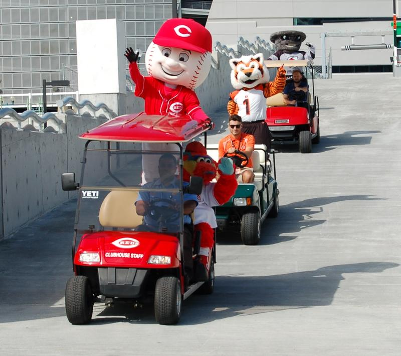 Mascots from the Reds, Bengals and Cyclones ride into the newest Banks parking garage.
