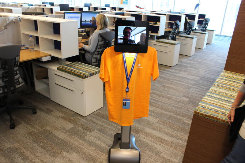 "This robot with video conferencing allows the missing employees to ""attend a meeting."""