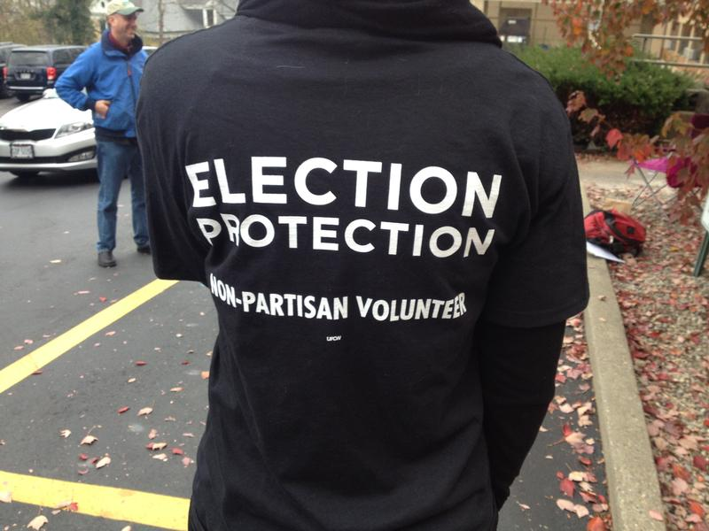 Monitors at polling places are not an uncommon sight this election day. These monitors are from the Jewish Reform Movement initiative called Nitzavim and are at the Judson Care Center in Westwood.