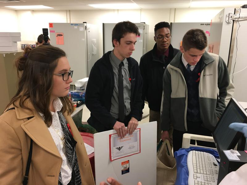 (from left) Lexie Adams, Maddox Linneman, Chase Harris and Sam Pannek are working on a cure for AIDS and visit UC's virology lab.