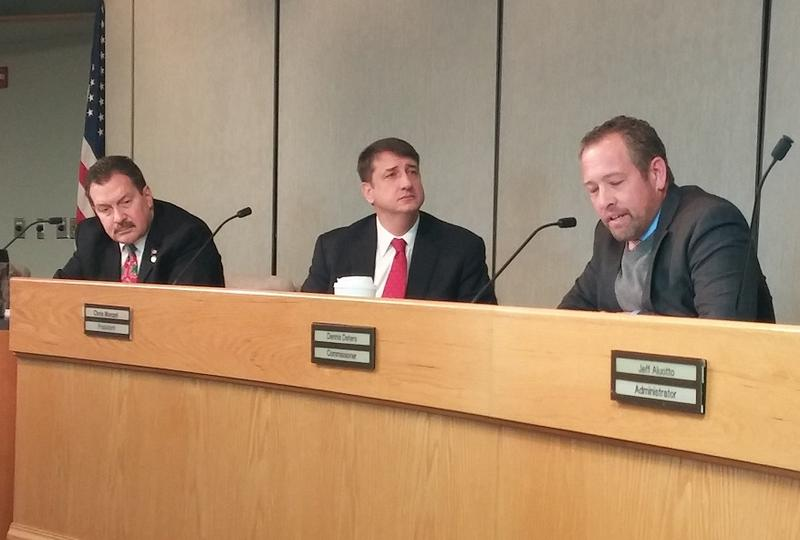 Commissioners Todd Portune and Chris Monzel listen as Dennis Deters speaks at his final board meeting.