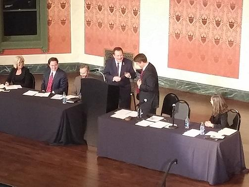 Commissioner Chris Monzel hands the gavel to newly elected Board President Todd Portune at Memorial Hall.