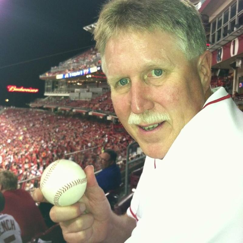 Tim Closson holds a foul ball he caught at Great American Ball Park