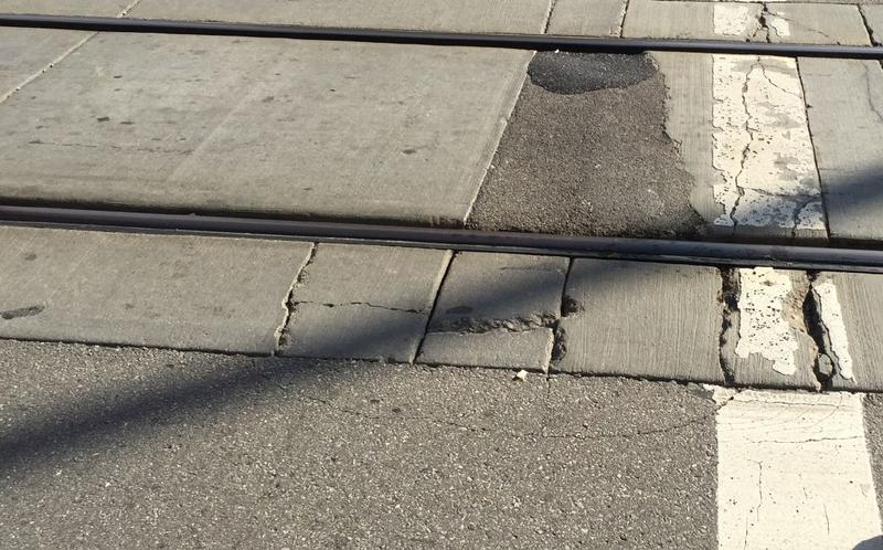 Crumbling concrete along part of the streetcar track on Walnut between Court and Ninth.
