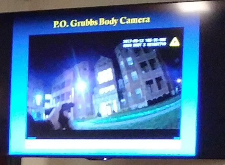 A video monitor shows the footage from Officer Kenneth Grubbs body camera after he was hit.