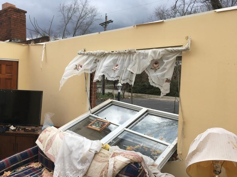 Carlon Addison's roof blew off when the storm passed through Amelia.