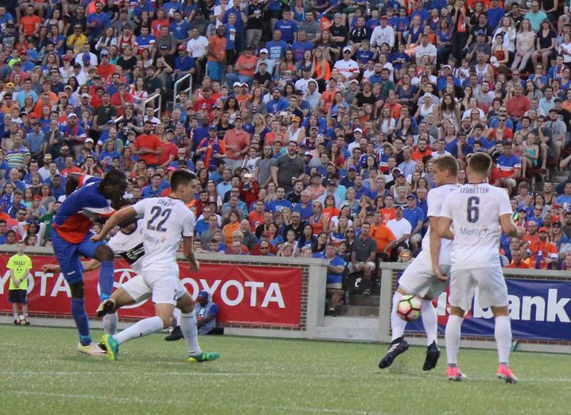 Djiby Fall, far left, shoots and scores a goal in FC Cincinnati's home opener April15, 2017.