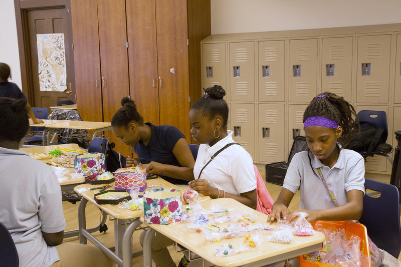 Students in Rothenberg's Student Enterprise Program make jewelry for their business.