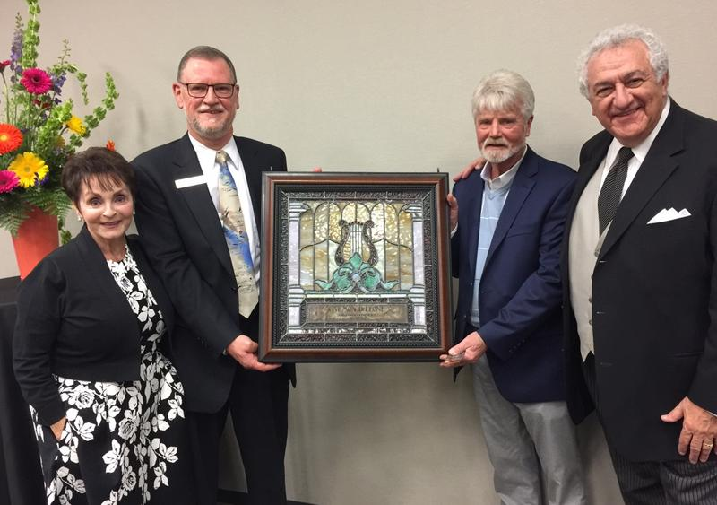 Carmon DeLeone was presented with a custom-made stained glass panel enshrined with his name and tenure with the orchestra. Pictured from left: Kathy DeLeone, MSO Board Director Stephen J. Ifcic, stained glass artist Jon Moorman, and Carmon DeLeone.
