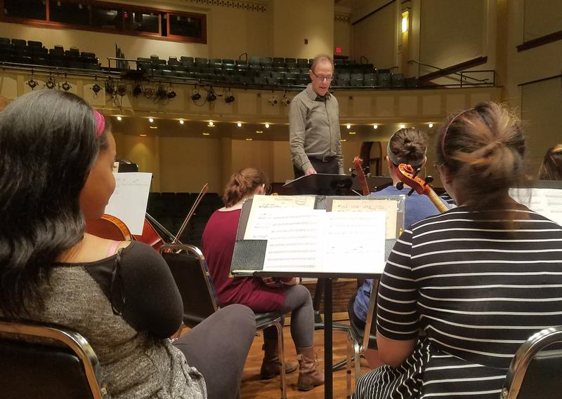 Conductor Ricardo Averbach leads rehearsal ahead of Thursday's premier of Arcade Variations.