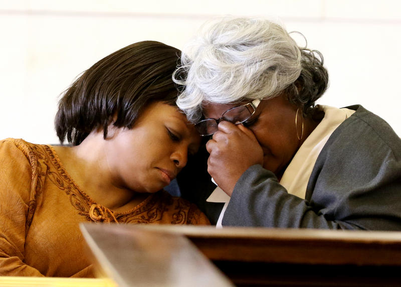 Terina Allen, left, and her mother Audrey DuBose comfort each other as video from the shooting death of DuBose's son, Sam DuBose is shown during the third day of testimony in the retrial of Ray Tensing.