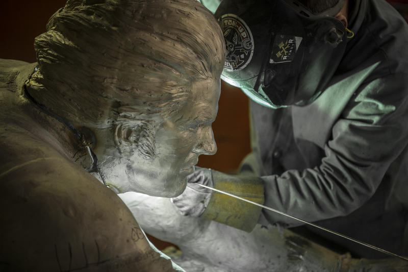 The head of the statue is positioned and welded to the body in the Sincerus Bronze Art facility in Indianapolis.