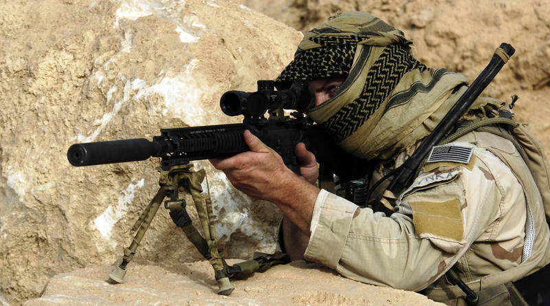 A U.S. Special Forces Soldier conducts rehearsal, training and pre-operation conformation on the MK 12 sniper rifle